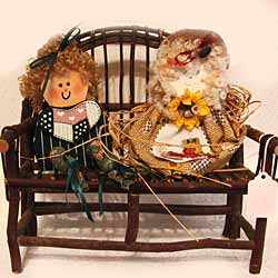 Handcrafted Dolls on Bench